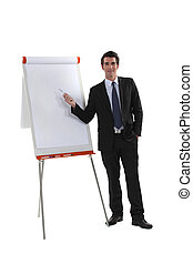 Executive standing next to a flipchart
