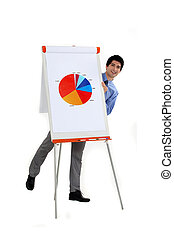 attractive businessman making presentation with pie chart