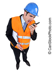 Engineer shouting into a two-way radio