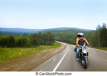 Travel on motorcycle - motorcyclist and passenger go on...