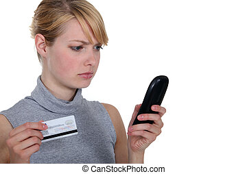 Woman calling her bank.