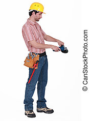 Manual worker stood with angle grinder