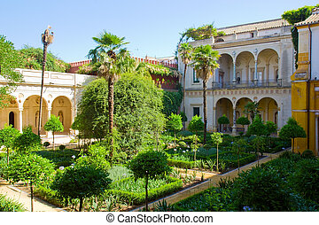 garden of Casa de Pilatos, Seville, Spain - Courtyard with...