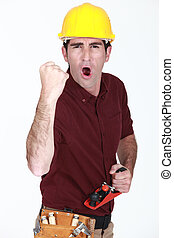 A victorious construction worker.