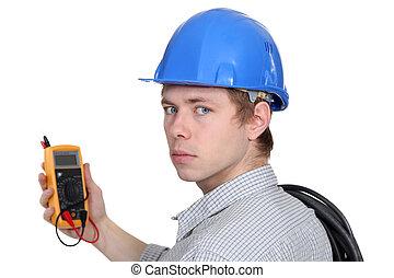 Man holding volt meter