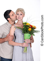 Man giving flowers to wife