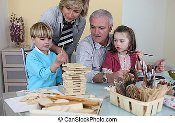 Couple playing with their grandchildren