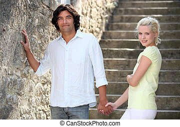 Couple walking down some stone steps