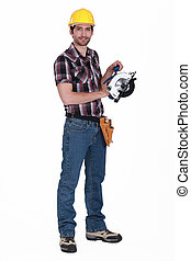 Worker holding circular saw