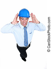 Man with helmet and unbearable noise