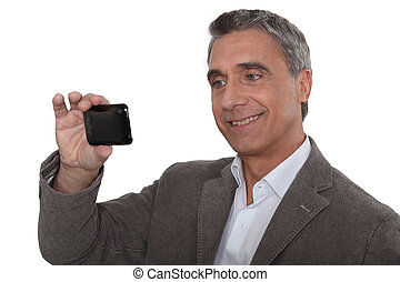 Man taking a self-portrait with his cameraphone