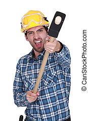 An angry construction worker with a sledgehammer