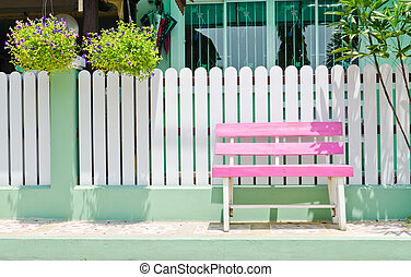 pink Wooden Bench - pink wooden bench in front of white...