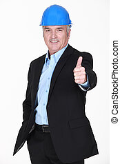 Middle-aged architect giving thumbs-up