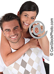 Couple holding at symbol