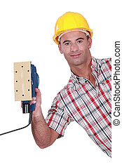 Worker with a sander