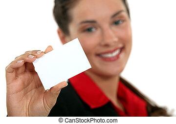 A businesswoman handing her card.