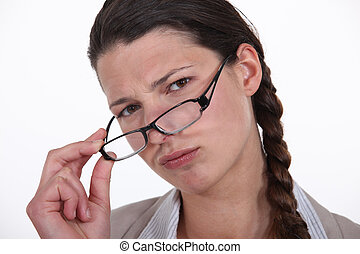 Businesswoman taking out her glasses.