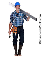 Construction worker carrying metal bean and hammer