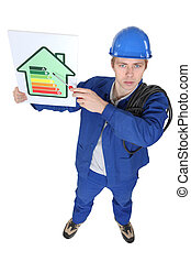 electrician showing the level of energy consumption of a...