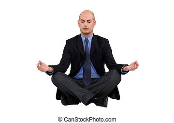 Businessman sat in yoga position