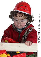Menino, tocando, construtor