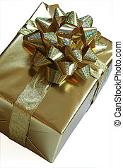 Gold present with ribbon - Luxurious gold gift wrapped with...