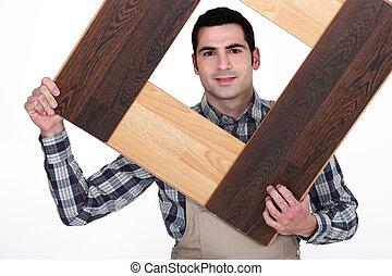Carpenter building a frame