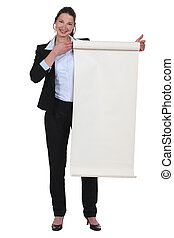 businesswoman holding a blank poster