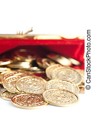 Scattered silver and gold coins are in red purse, isolated...