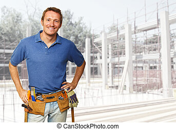 smiling labor - smiling handyman at construction site