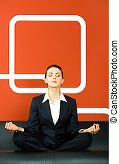 Meditation - Image of business woman sitting on the sofa in...