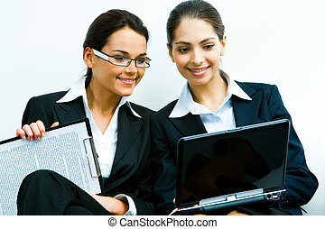 Working women - Portrait of two confident women in suits...