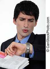 Businessman looking at his watch