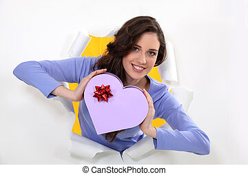 woman holding a box shaped as a hearth