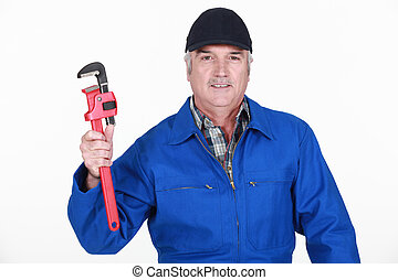 Grey haired man holding wrench