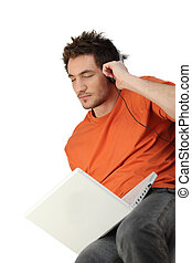 Man listening to music on computer