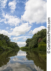 River Reflections - Cloudy summer sky reflected in the River...