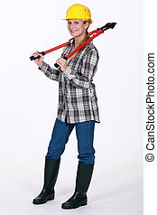 Tradeswoman carrying a pair of large clippers around her...
