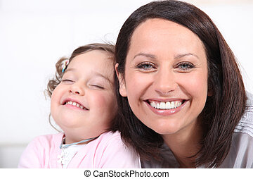 Mother and baby laughing