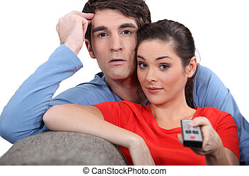 Couple with a remote control