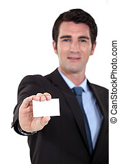 Executive proffering his businesscard
