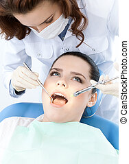 Checking the dentes up - Dentist's assistant checks up the...