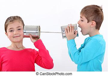 niños, el comunicarse, estaño, latas
