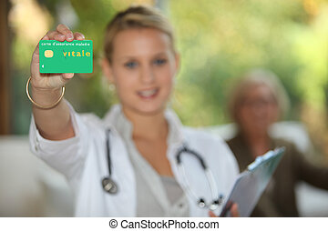 young doctor showing card