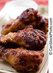 Chicken wings - A shot of chicken wings on a plate