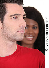 Woman smiling and serious man