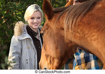Woman spending time with her horse