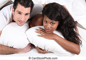 Married couple lying in bed