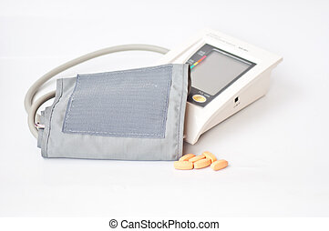 sphygmomanometer and drug on white background